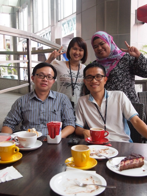 Last day. Surprised farewell tea-time at Secret Recipe. Behind me is Fara, my team leader. Next to her is Veronica, my good 'neighbor'.